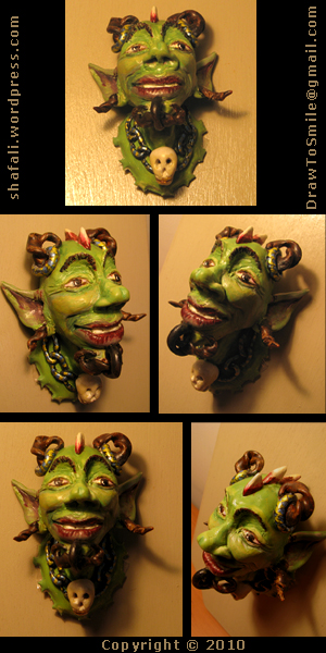 A Caricature, Cartoon Sculpture of the horned Devil in Polymer Clay.